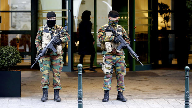 "Belgian soldiers stand guard outside the Radisson Blu hotel in central Brussels, November 21, 2015, after security was tightened in Belgium following the fatal attacks in Paris. Belgium raised the alert status for its capital Brussels to the highest level on Saturday, shutting the metro and warning the public to avoid crowds because of a ""serious and imminent"" threat of an attack.  REUTERS/Youssef Boudlal"