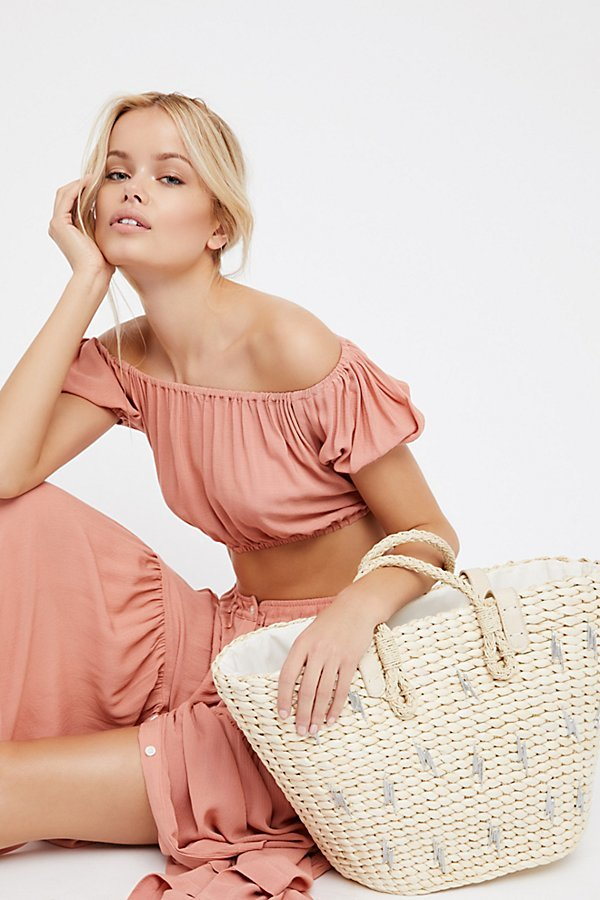 SUNDRENCHED STRAW TOTE BY FREE PEOPLE
