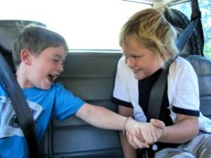There's nothin' like a lil' arm wrestling in the car to pass the time away.