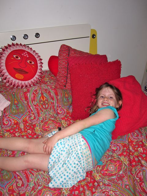 Gigi's chillin' on her bed.