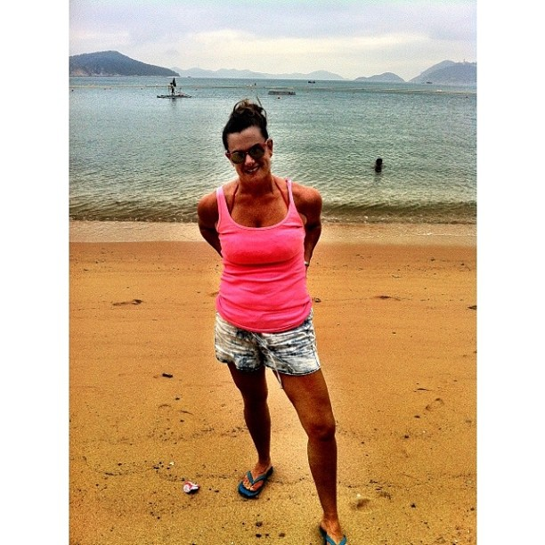 Beach Ready in Acid Wash Jeans and a Bright Pink Tank
