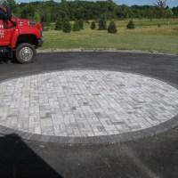 Circle Brick Paver Inlay in Driveway