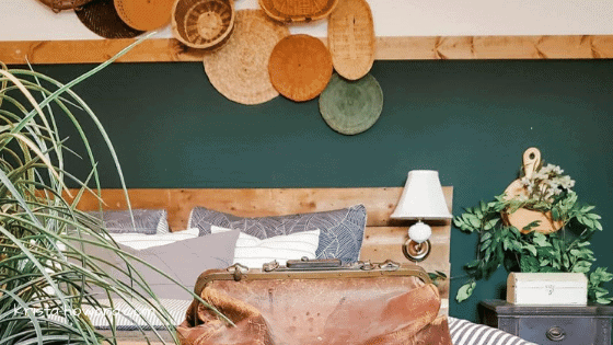 Green bedroom wall with wall baskets