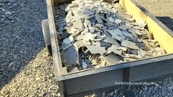 Trailer full of ripped up tile flooring