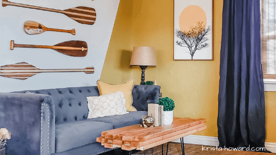 yellow living room wall with gray couch
