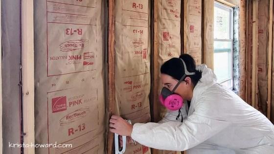 Woman Stapling Insulation