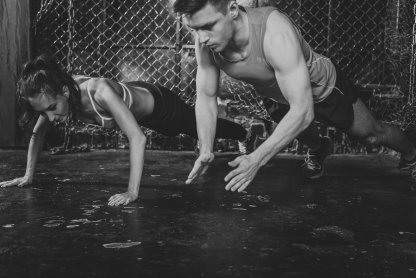 Sportsmen. fit male trainer man and woman doing clapping push-ups explosive strength training concept crossfit fitness workout strenght power.