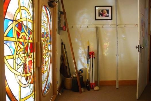 Kristen Gilje Glass doors make color art on entryway walls