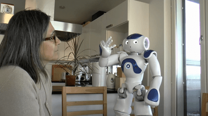 Kristiina with robot at home