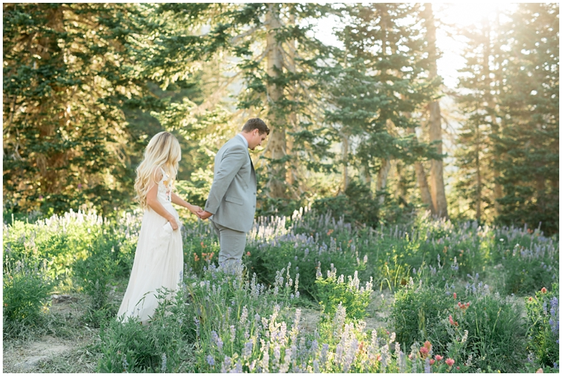 engagements, sunlight, mountains, wildflowers, mountain engagments, summer engagements, hair goals, engagement dresses, floral dress, grey suit, www.kristinacurtisphotography.com