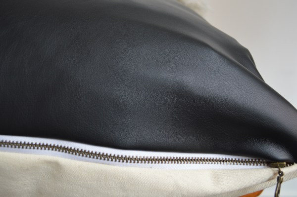 black faux leather + white mudcloth pillow