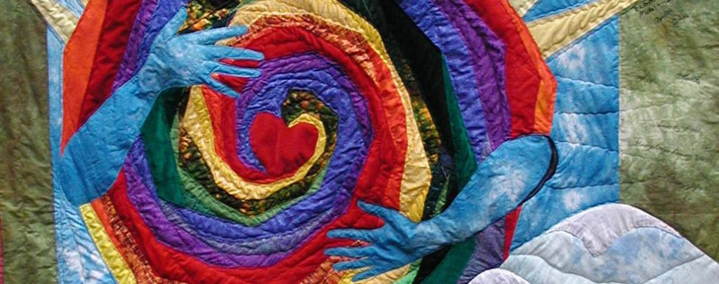 Quilt Commission with images of heart, hand, spiral