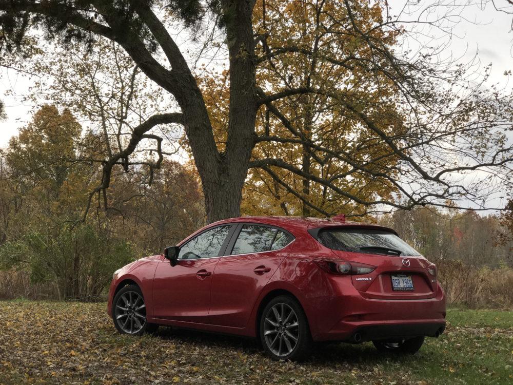 Mazda3 Grand Touring under tree