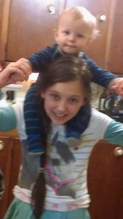 Baby C's new favorite game: riding piggy back on Miss A.  It must be fun to have a big sister ten years older than you!