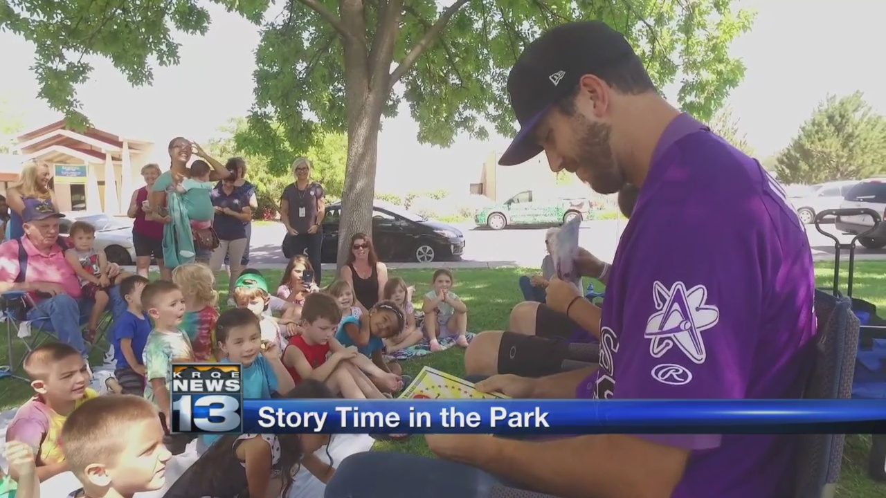 Isotopes pitchers read to kids at 'Story Time in the Park'_1531871464468.jpg.jpg