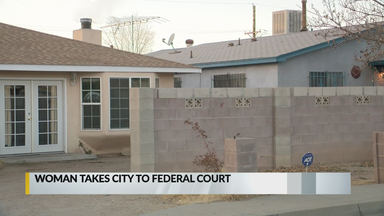 Albuquerque woman sues for right to live in home without water, power_1553141588416.jpg.jpg