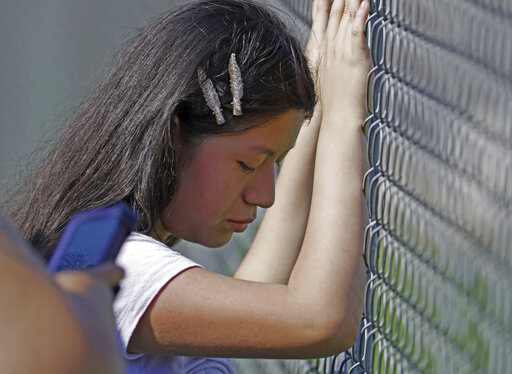 Immigrants lock doors, rally around children of detained | KRQE News 13