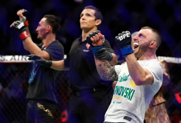 Usman batters Covington, Volkanovski claims title at UFC 245