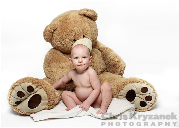 baby with giant stuffed bear with white background