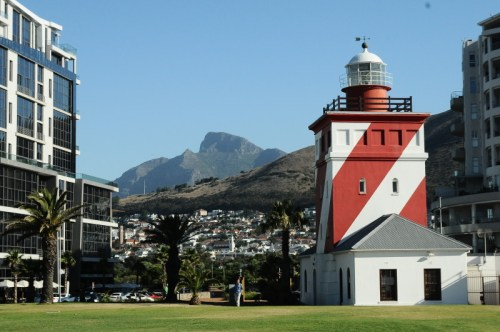 The lighthouse in Mouille point with view of Lions Head