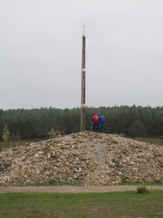 "View of ""La Cruz de Ferro"" on a rainy day. It is the highest point on The Camino."