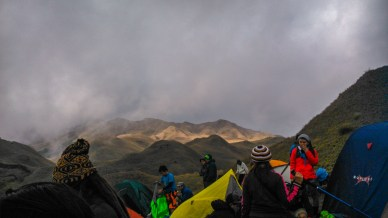 At the background of the campers is the grassland section of Mt. Pulag enroute to summit.