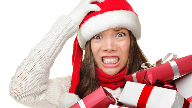 Christmas stress - busy woman wearing santa hat stressing for ch_484598