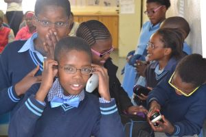 Kagiso Shanduka Trust (KST) young school pupils wearing spectacles