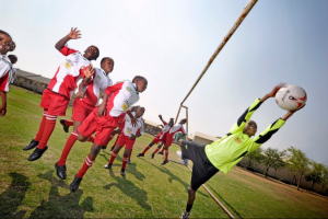 Kagiso Shanduka Trust (KST) South African school children playing soccer