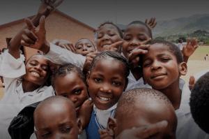 Kagiso Shanduka Trust (KST), happy South African school kids smiling