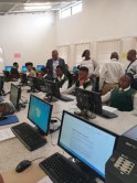 MEC Dr PHI Makgoe FSDoE interacting with learners from Phephetso Secondary School in their renovated Computer Laboratory