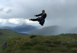 Jump kick with mountains in background