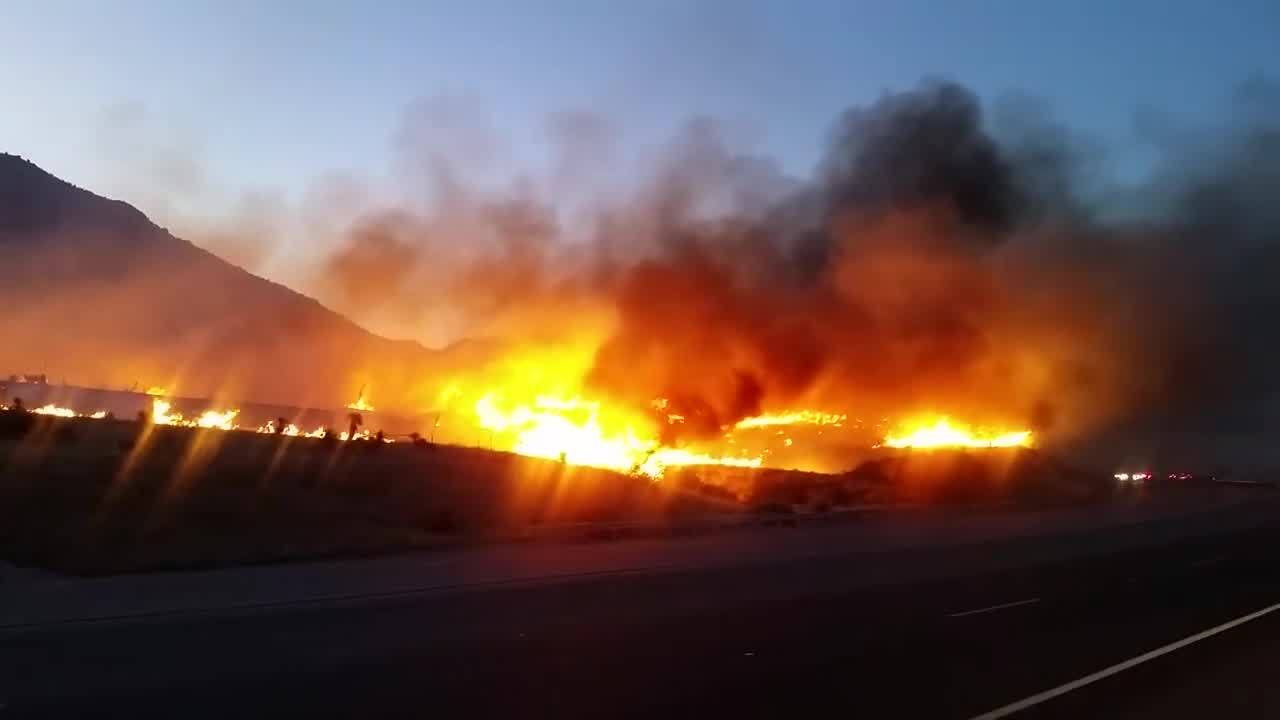 Fire crews continue monitoring scene of large brush fire along Highway 70