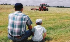 Man and Son watching Tractor