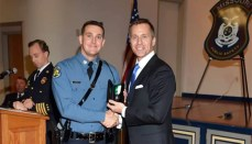 Staff Sgt Austin Kings and a member of the Highway Patrol receives Medal of Merit
