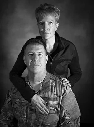 Susi Boudreaux and her husband, Col. John Boudreaux, have been married for over 28 years. On September 2016, John suffered an out-of-hospital cardiac arrest requiring quadruple heart bypass surgery, a situation less than one percent of victims live through. For months, Susi bathed, fed, and caretook for John as he was incapable from caring for himself. Now turning 53 this month, John wouldn't have been able to live without her.