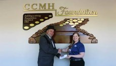 Masonic Lodge Past President, Richard Albrecht, and CCMH Director of Marketing & Public Relations, Rachel Davidson