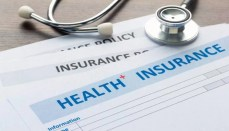Health Insurance paperwork with Stethoscope