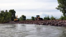 Heavy Equipment Repairing a Levee