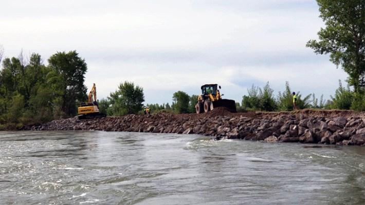 Heavy Equipment Repairing a Levee