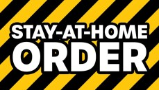 Stay At Home Order with black and yellow caution stripes