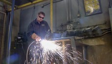 Scott Hoad Marine Veteran Welding in a shop