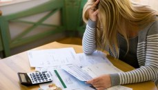 Woman struggling over finances (money)