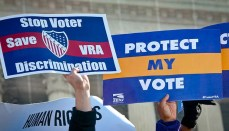 Protesters with stop discrimination signs and protect vote