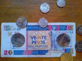 Bild: CUC-Scheine und Münzen
