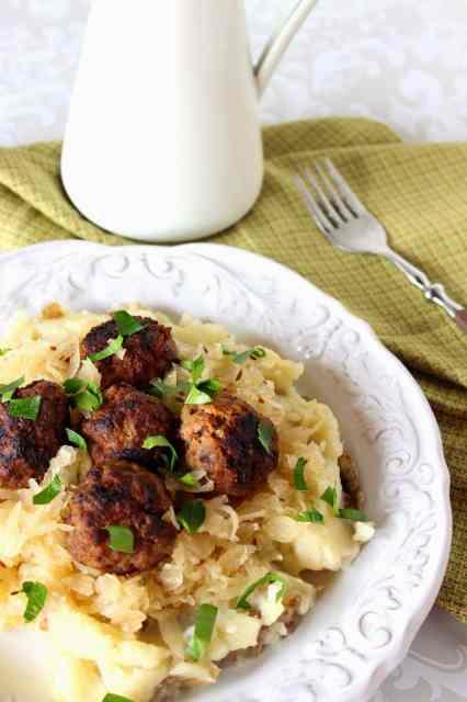 German Meatballs Over Mashed Potatoes and Sauerkraut