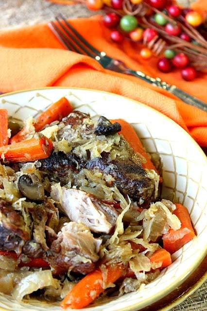 German Pork Ribs with Sauerkraut for the slow cooker with carrots, and onions. A delicious German meal with minimal hands-on preparation time. - www.kudoskitchenbyrenee.com