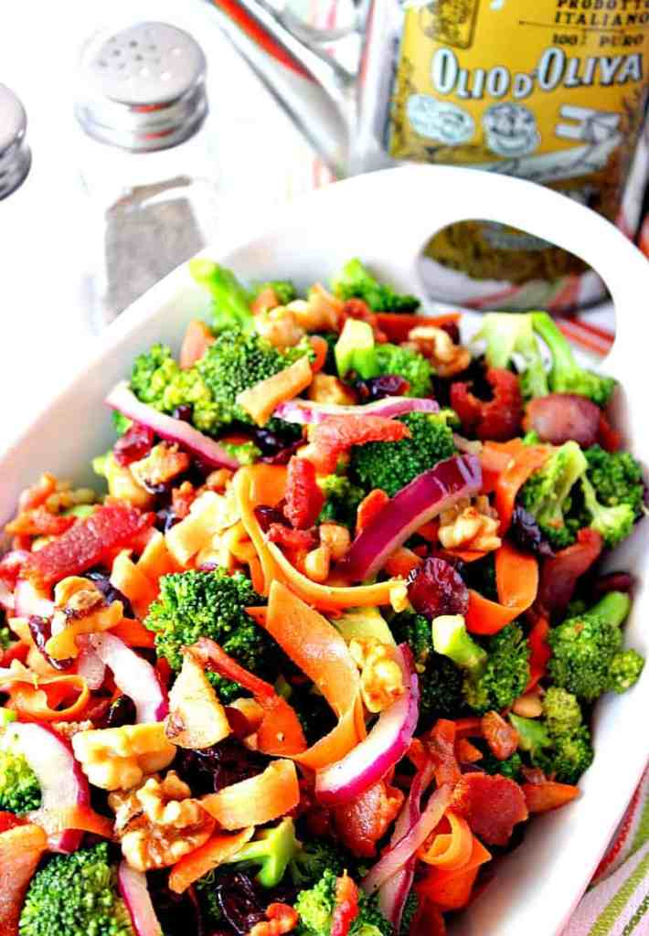 Healthy Broccoli Salad with carrots, walnuts, bacon, cranberries, and red onion. | Kudos Kitchen by Renee