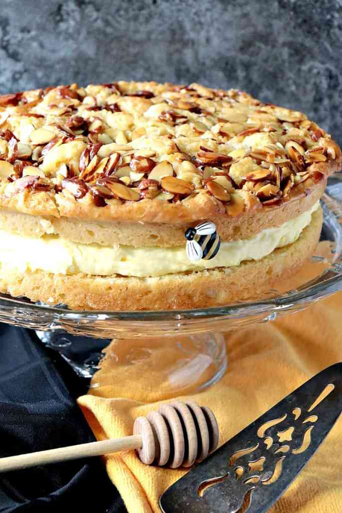 German Bee Sting Cake is a yeasted cake with a beautiful texture, fantastic honey flavor (hence the name), a beautifully caramelized almond topping, not to mention the thick, creamy vanilla filling. It's honestly the best cake I think I've ever made, and it's a recipe I'm super excited to share with for #SummerDessertWeek 2018. - kudoskitchenbyrenee.com