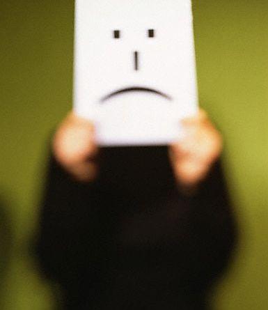 Holding Up a Sad Face